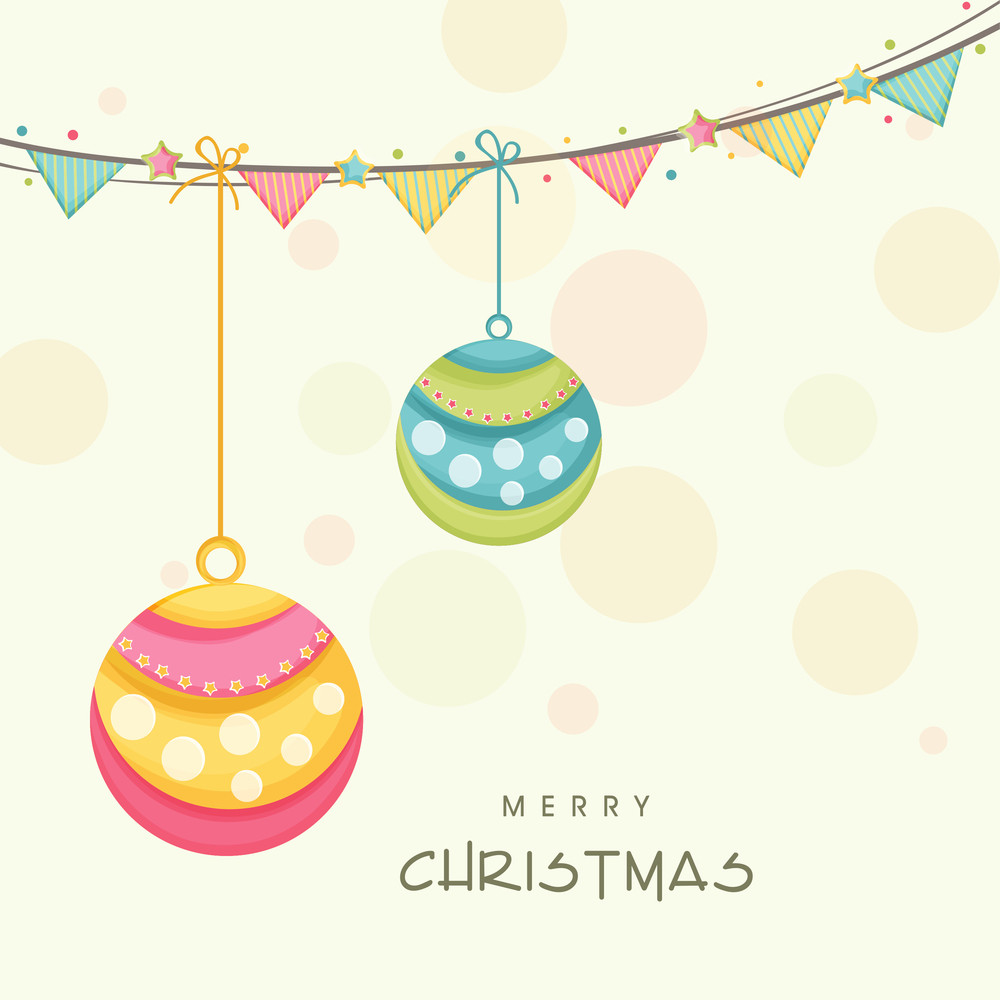 Hanging colorful Xmas ball with party flag for Merry Christmas celebration on beige background.