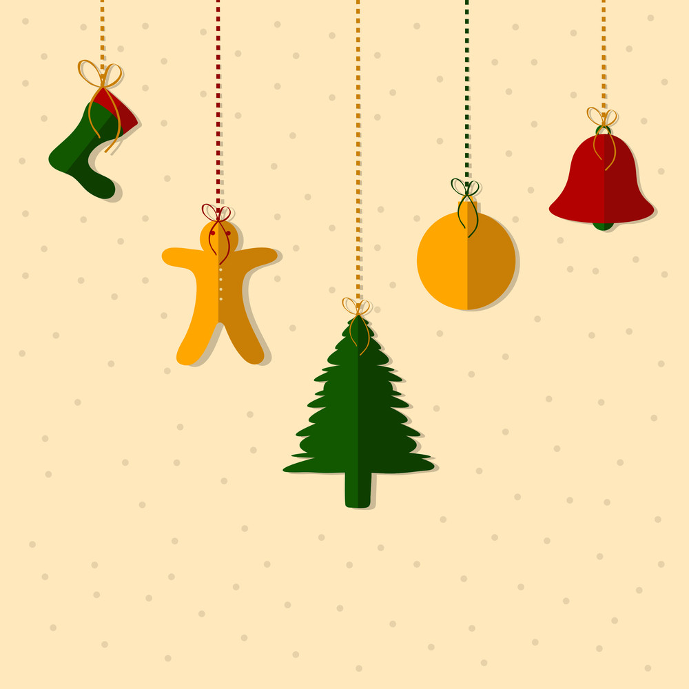 Hanging colorful Christmas objects on beige background for Christmas and other occasion.