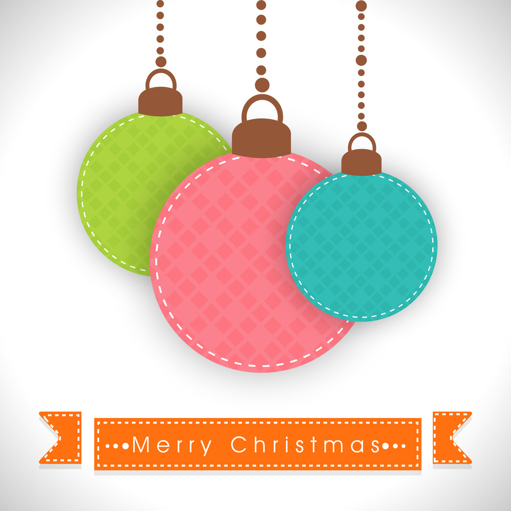 Hanging decoration balls with stylish text of Merry Christmas on ribbon.