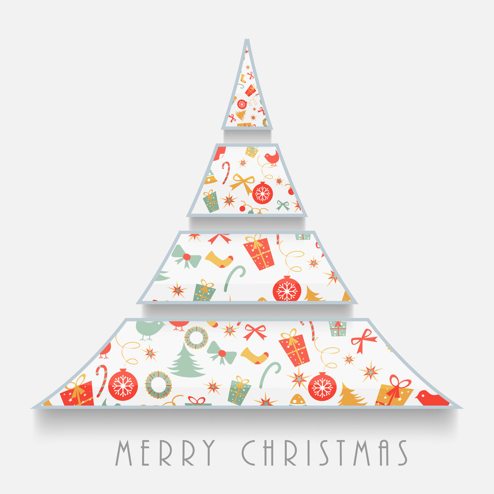 Creative X-mas Tree decorated with colorful ornaments on grey background for Merry Christmas celebrations.