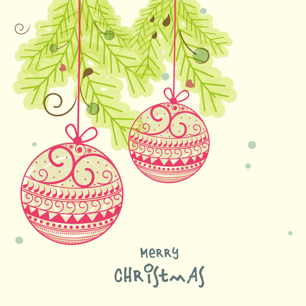 Beautiful floral design decorated X-mas balls hanging on fir trees for Merry Christmas celebrations.