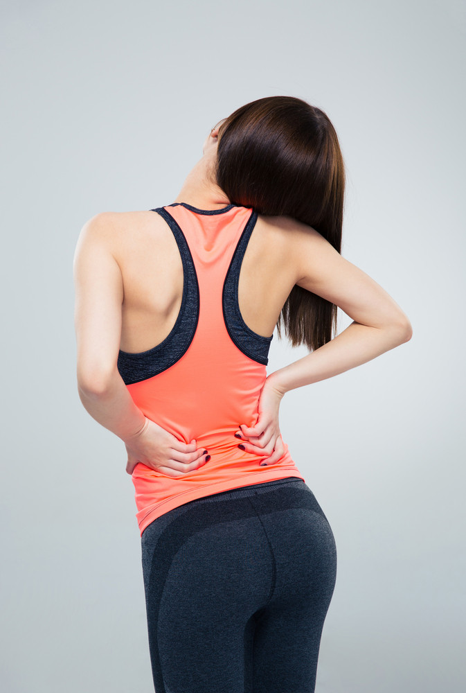 Fitness woman having back pain
