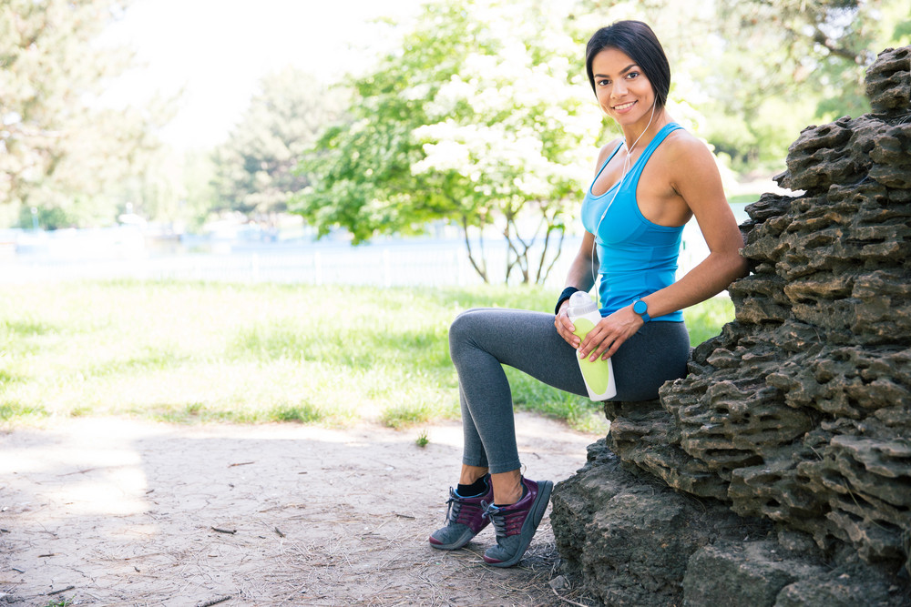 Portrait of a fitness woman resting outdoors