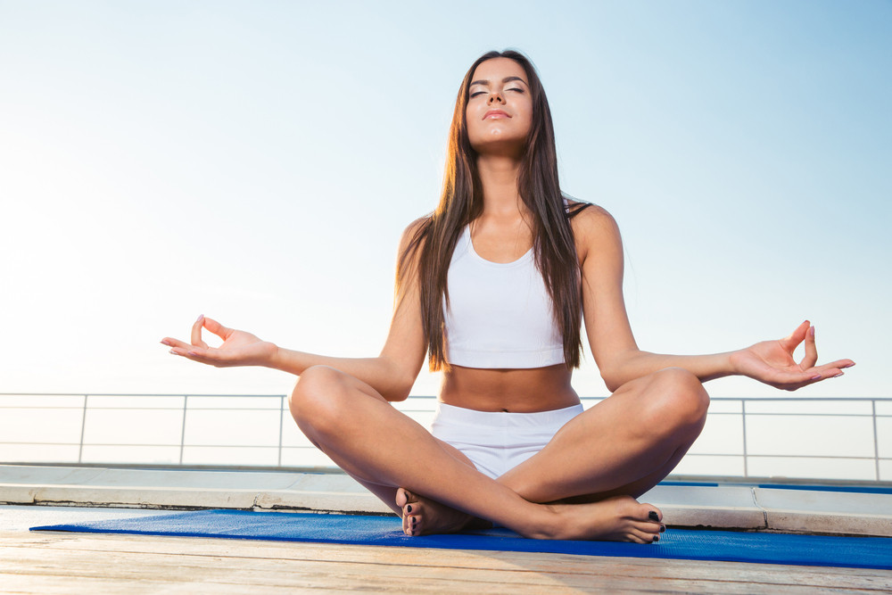 Portrait of relaxed woman meditating