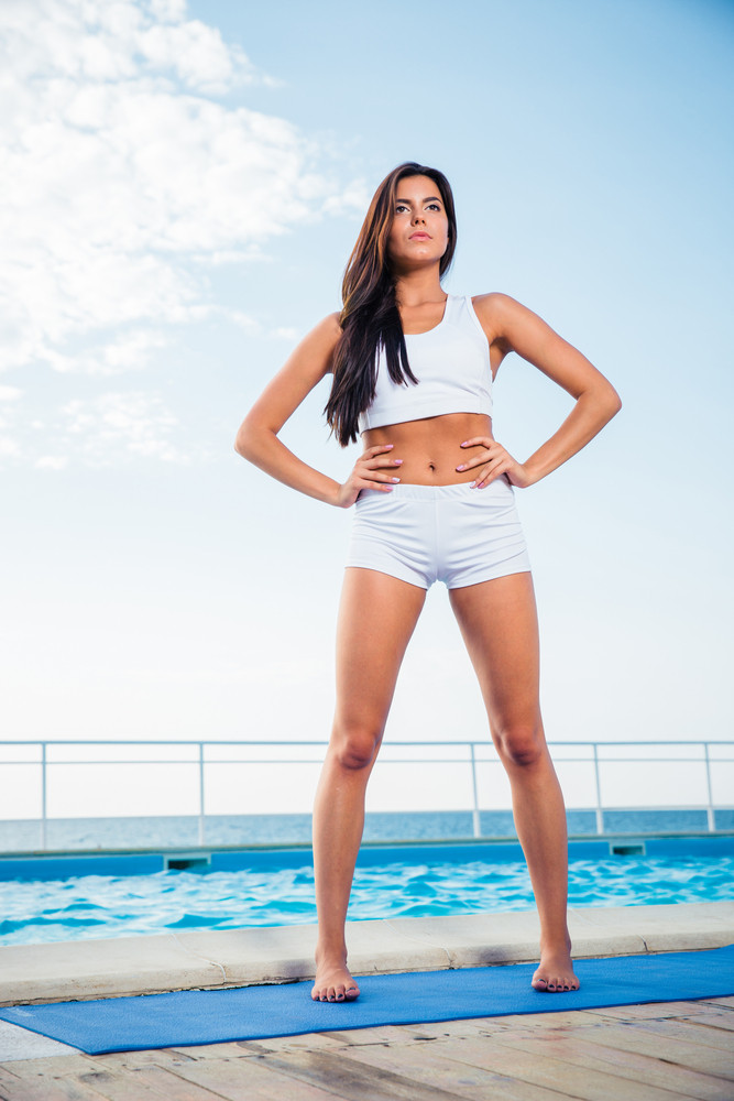 Portrait of a fitness young girl outdoors