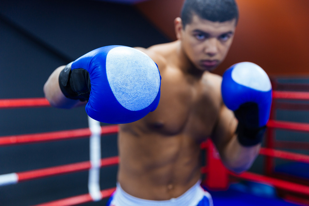 Boxer fighting in boxing ring