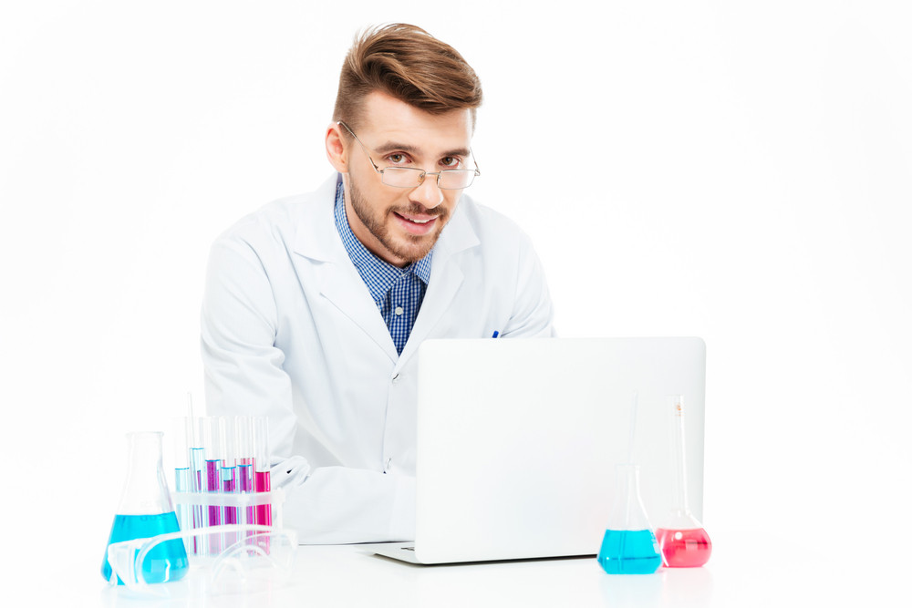 Chemist using laptop computer