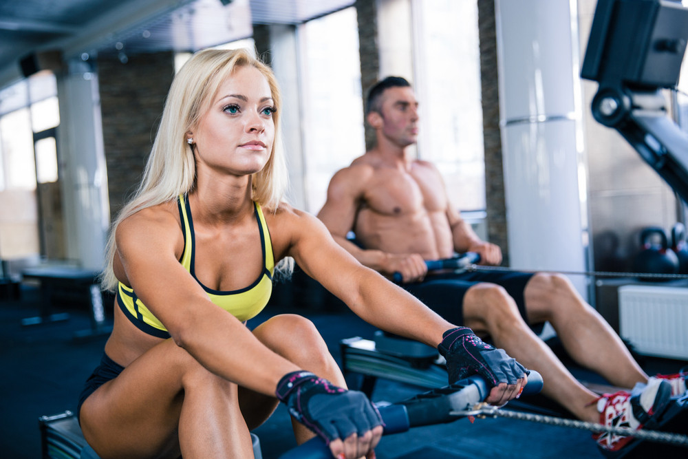 Man and woman workout on training simulator