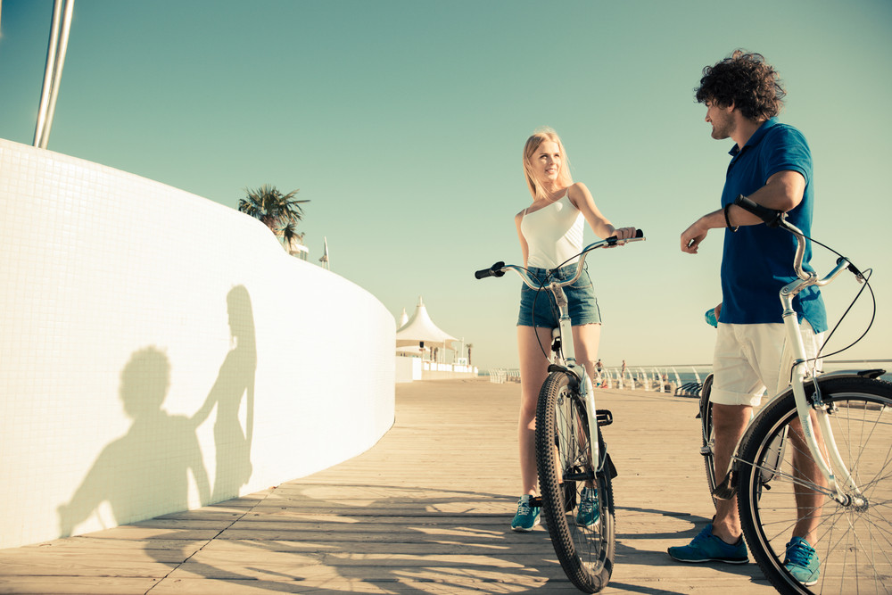 Man and woman with bicycle outdoors