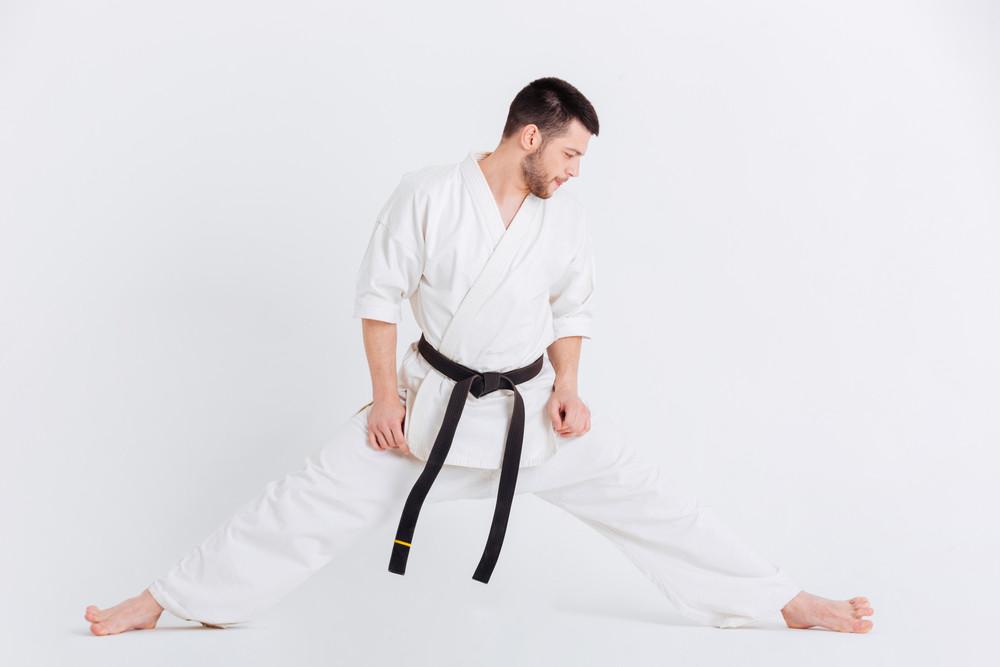 Man in kimono doing stretching exercises