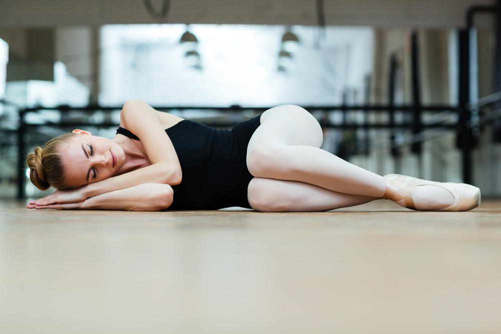 Ballerina sleeping on the floor