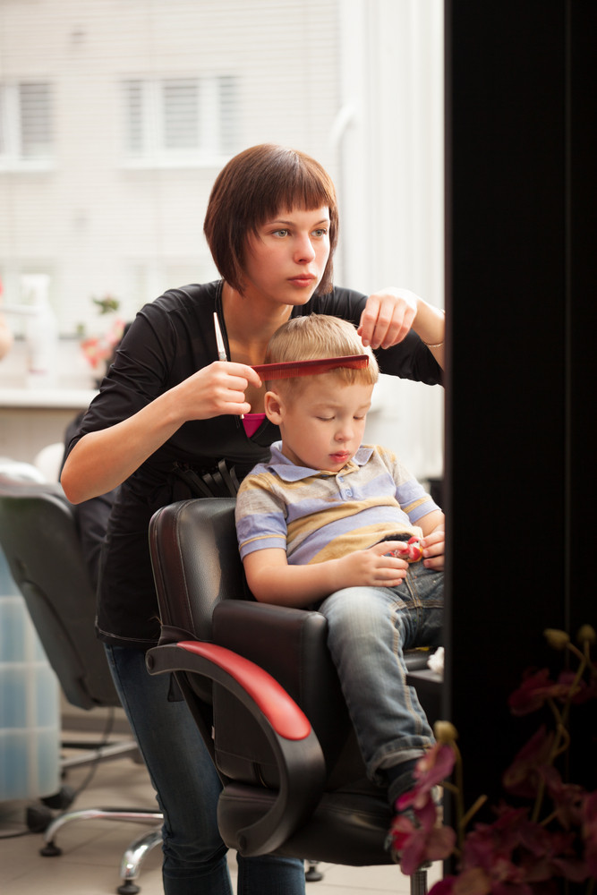 Little Boy Getting A Haircut From Hairdresser Royalty Free Stock