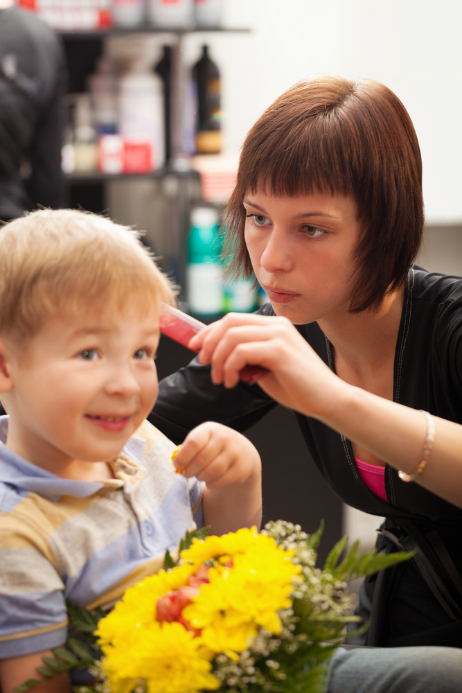 Young Boy Getting Haircut From Styist