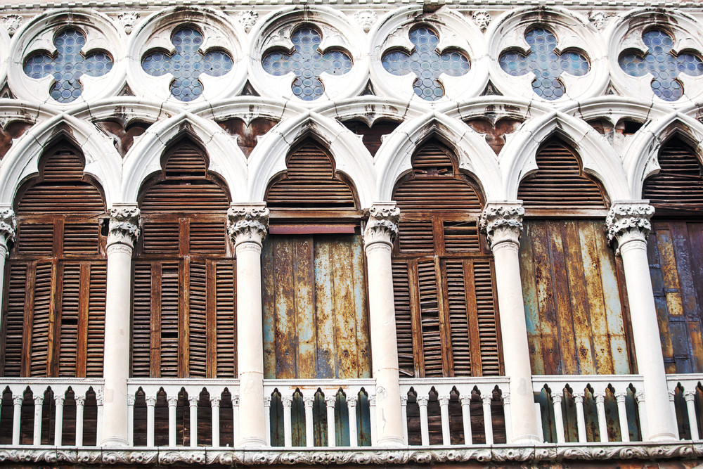 Ancient building with worn facade in venice