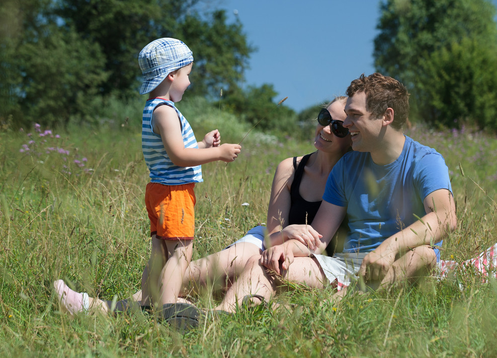 Family outdoor on a bright summer day