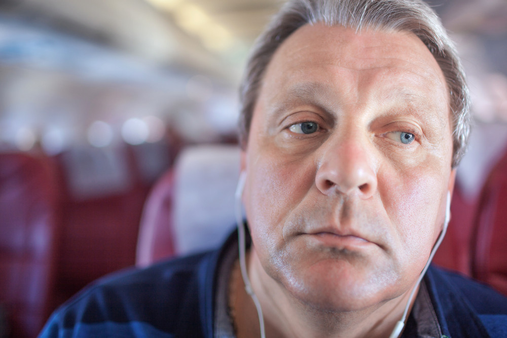 Man listening to music in the airplane