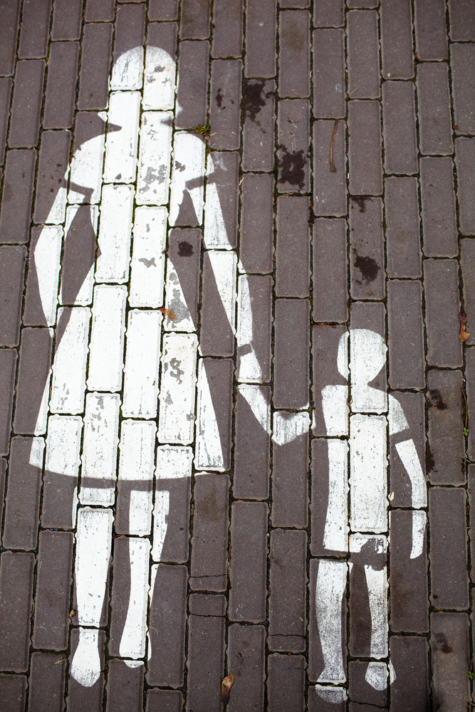 Road sign mother and a child