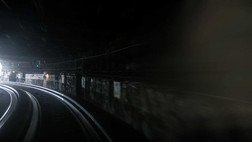 Fast subway train under blue and yellow light