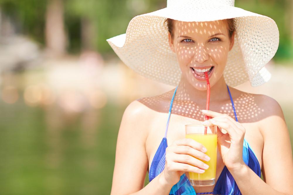 Woman In Bikini Drinking Orange Juice