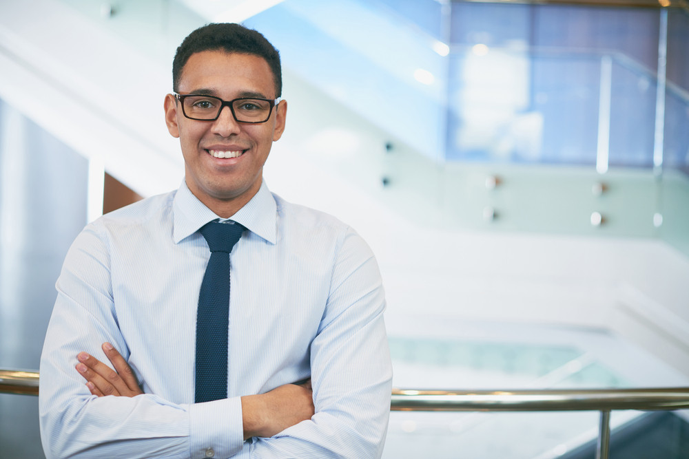 Happy Cross-armed Businessman Looking At Camera