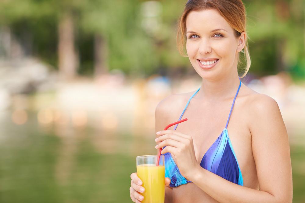Beautiful Woman In Bikini With Glass Of Juice
