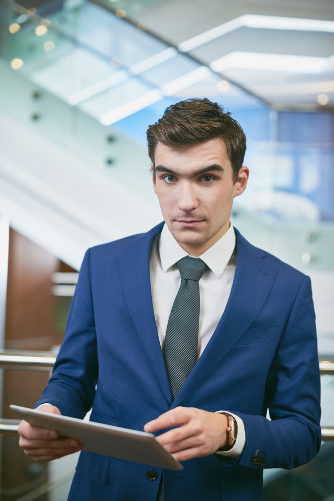 Elegant Young Businessman Using Touchpad