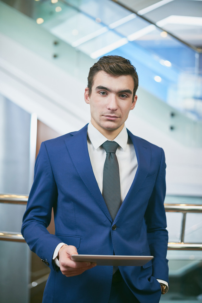 Elegant Businessman With Touchpad Looking At Camera