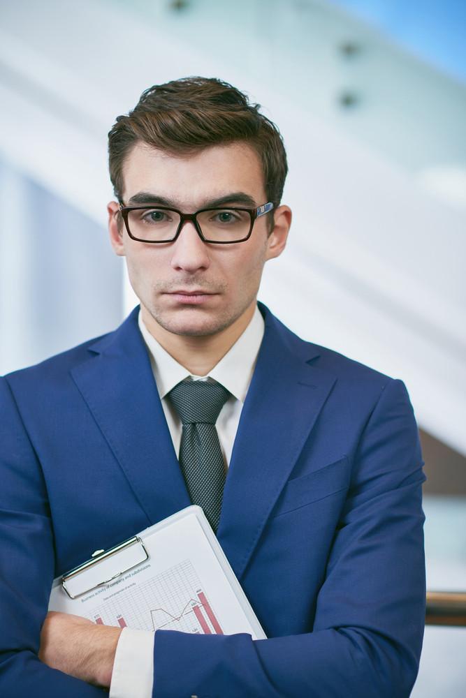 Elegant Manager In Eyeglasses Looking At Camera