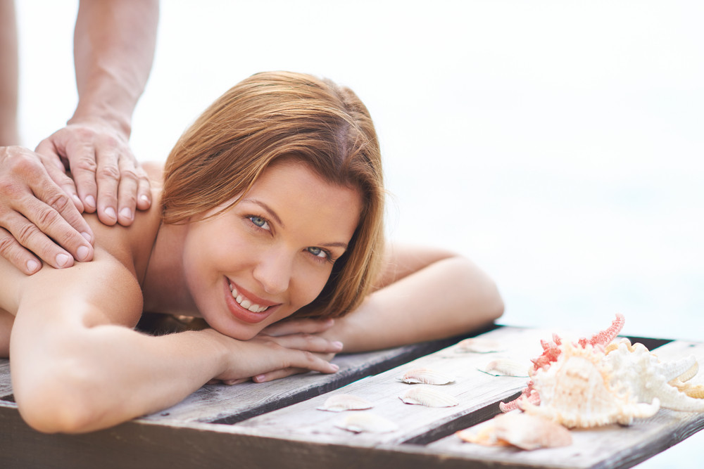 Young Woman Being Massaged Outdoor
