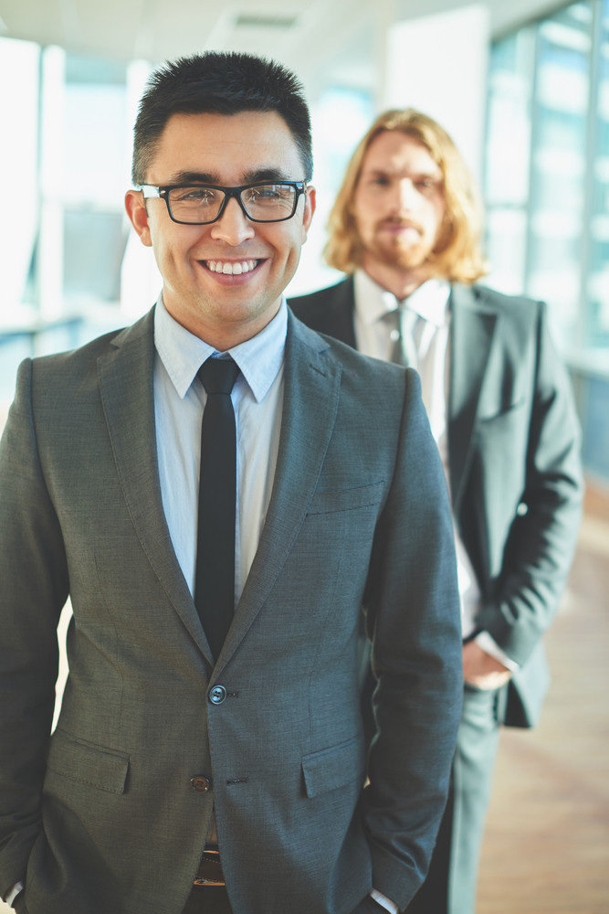 Happy Businessman In Suit And Eyeglasses Looking At Camera