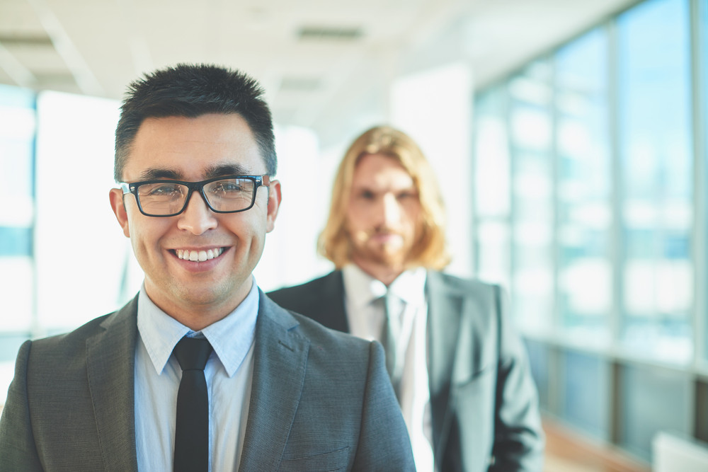 Happy Businessman With Toothy Smile Looking At Camera