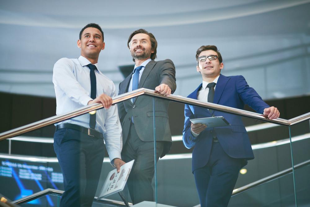 Three Elegant Businessmen In Formalwear