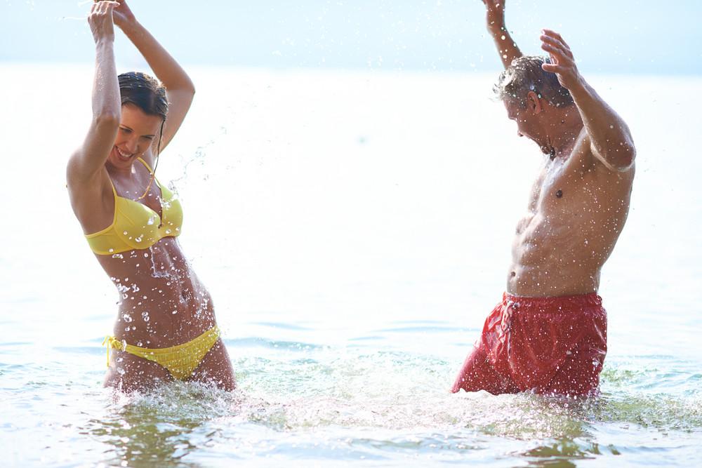 Couple Having Fun In Water