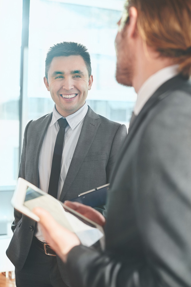 Happy Businessman Talking To His Colleague On Working Day
