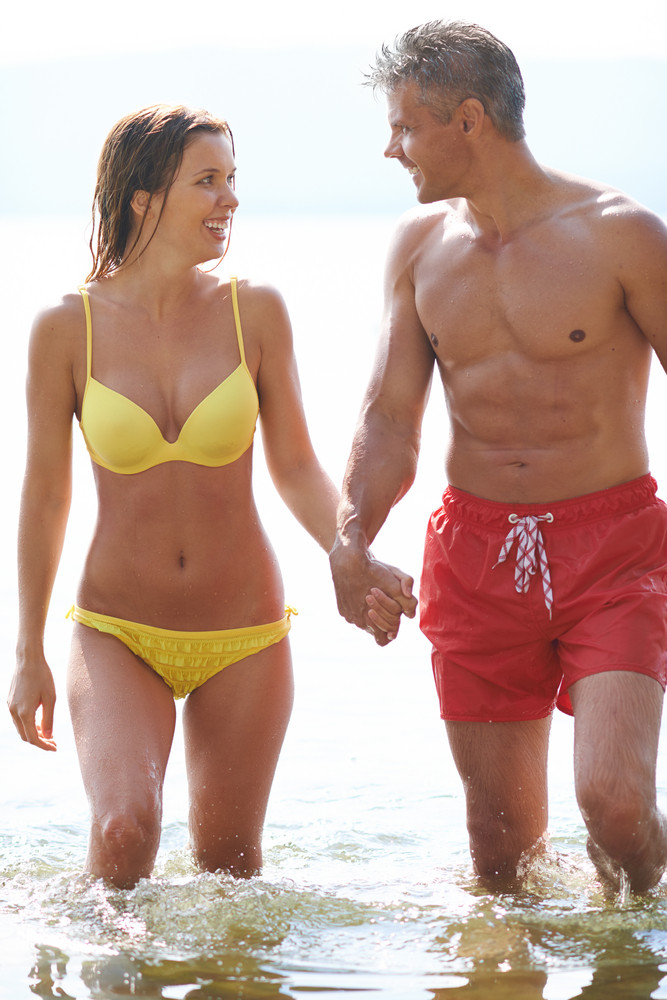 Happy Couple Spending Time On The Beach
