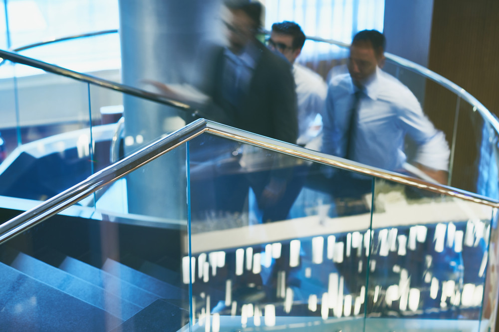 Group Of Businessmen Going Upstairs In Office Building