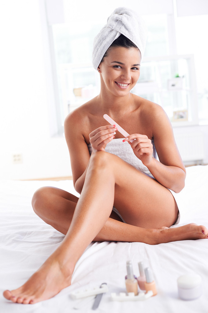 Girl With A Towel On Her Head And Body Taking Care Of Her Fingernails