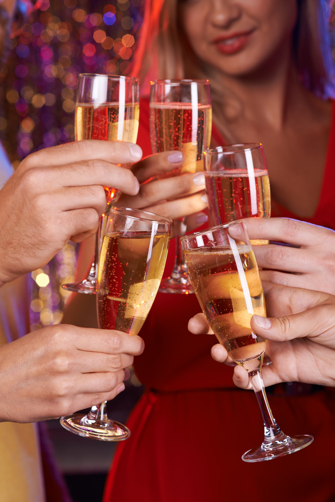Human Hands With Champagne Flutes Toasting At Party