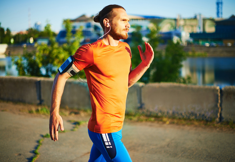 Portrait Of Young Attractive Sportsman Running Outside