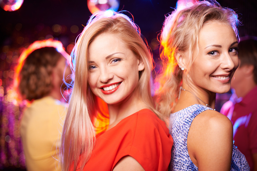 Image Of Two Happy Girls Looking At Camera At Party