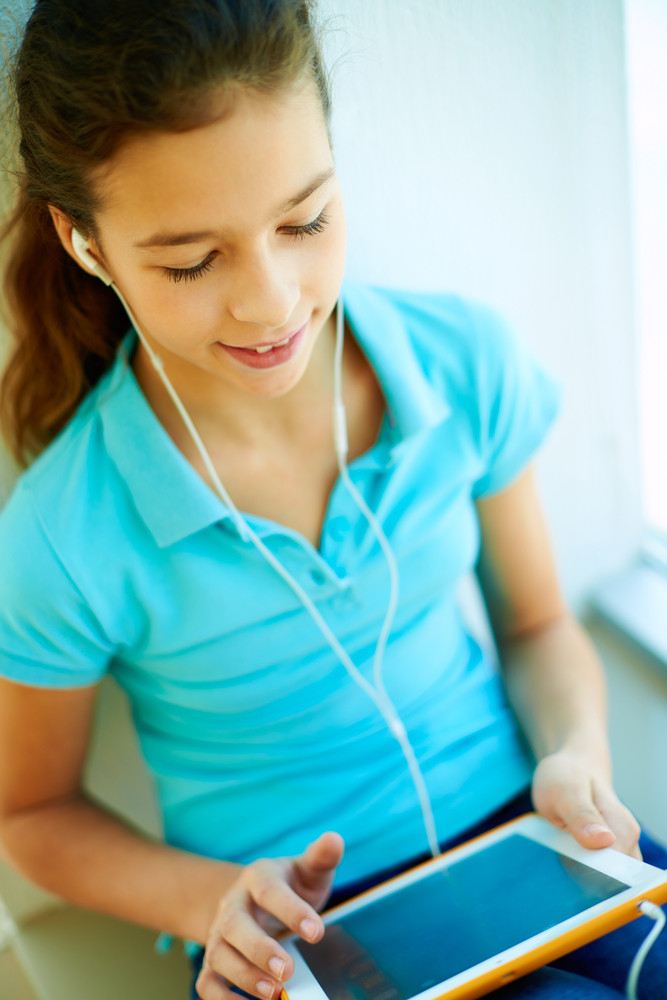 Cheerful Teenager With Digital Tablet Listening To The Music