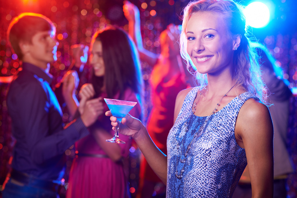 Beautiful Girl With Cocktail Looking At Camera At Party