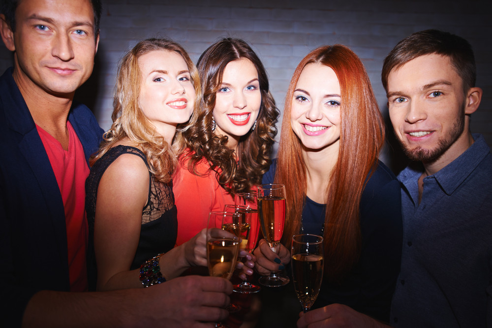 Cheerful Friends Toasting With Champagne At Party