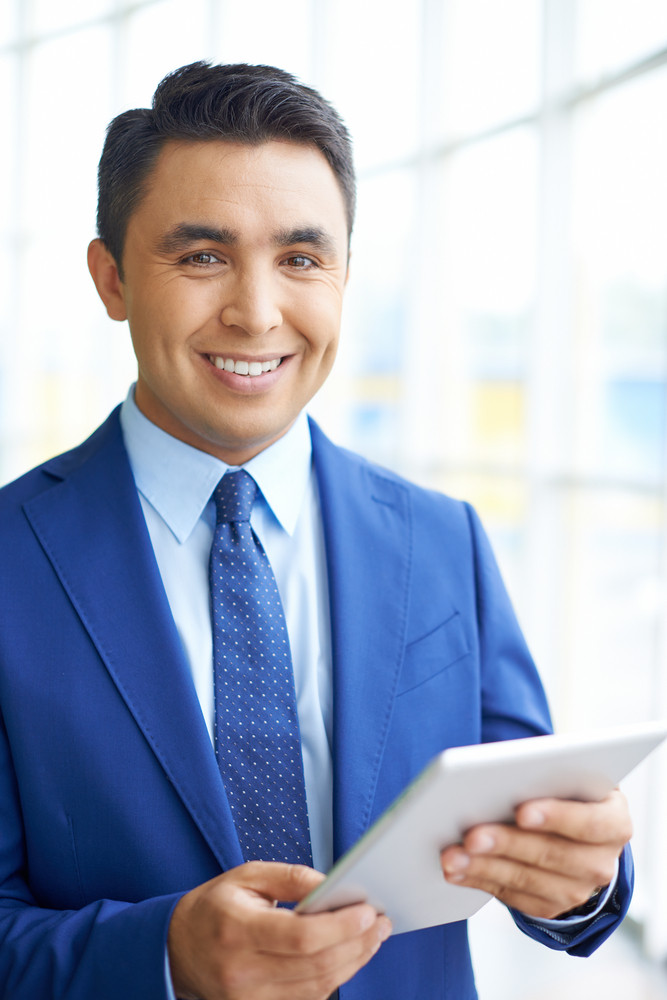 Image Of Young Businessman With Touchpad Looking At Camera With Smile