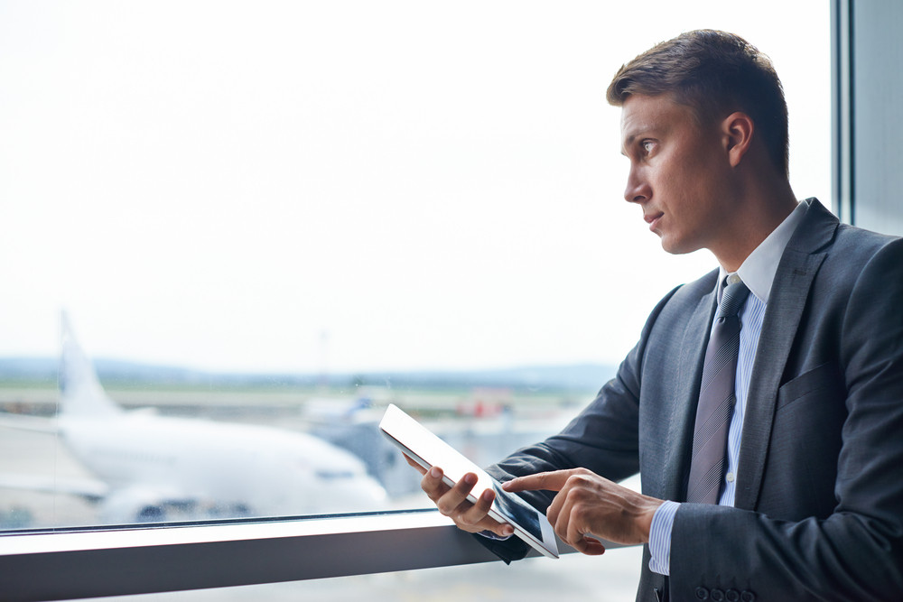 Serious Businessman With Digital Tablet In Airport