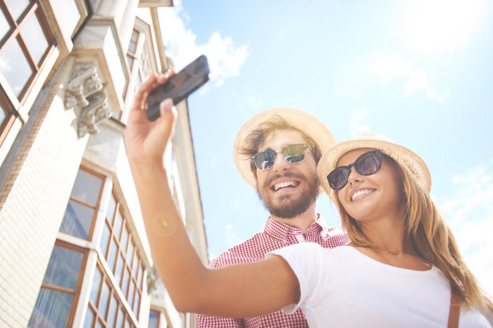 Happy Girl Making Selfie With Her Boyfriend Near By