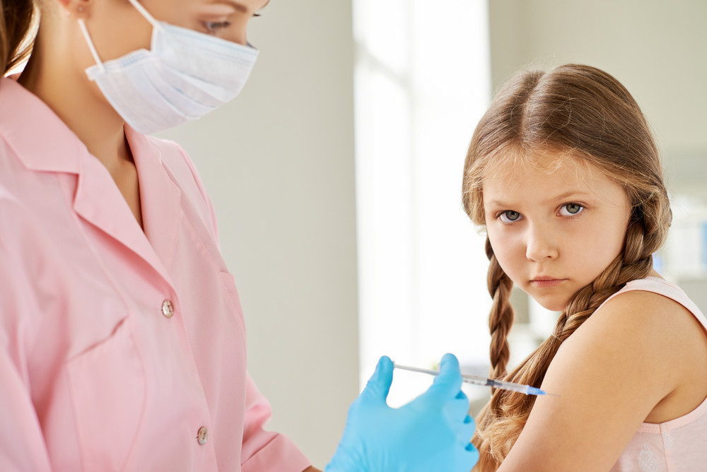Sulky Girl Looking At Camera While Doctor Making Her An Injection In Clinics
