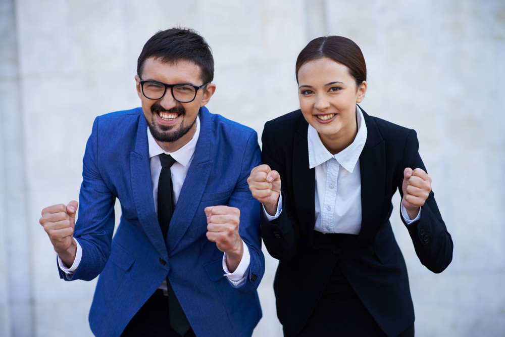 Image Of Two Ecstatic Colleagues Showing Their Gladness And Looking At Camera