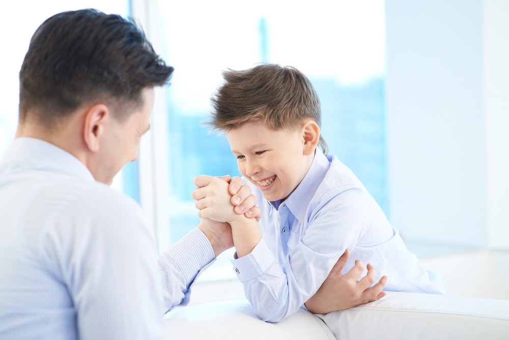 Photo Of Little Boy And His Dad Armwrestling