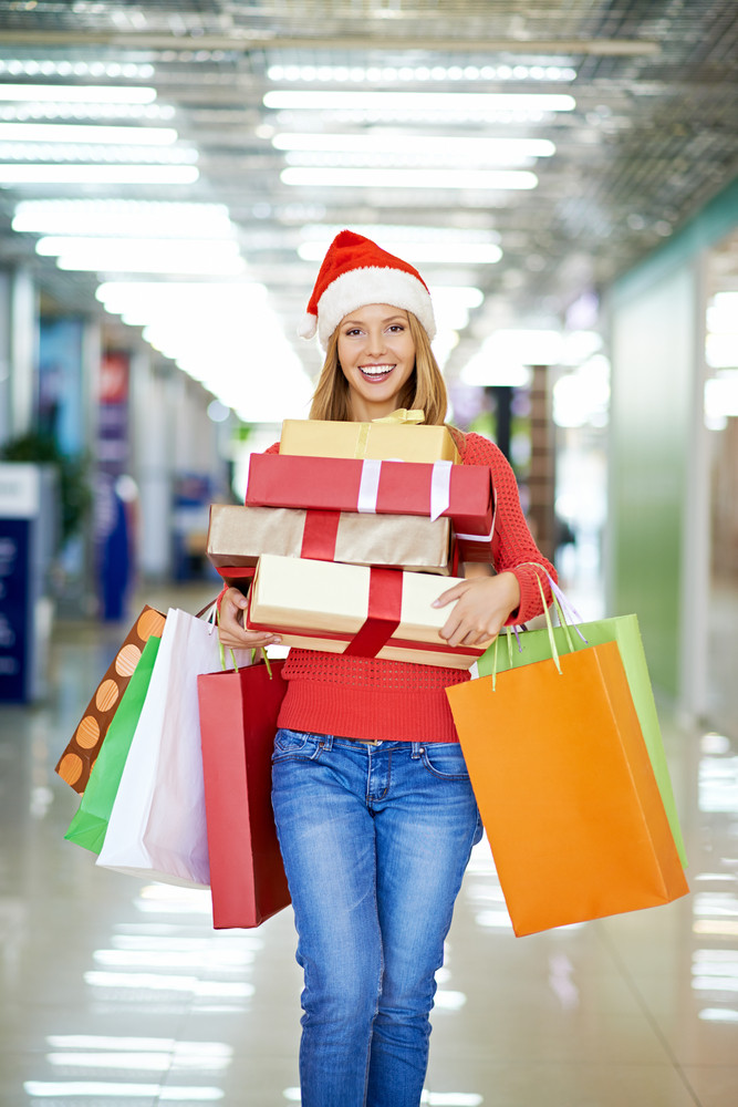 Young Woman Carrying Her Christmas Purchases
